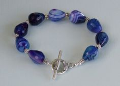 Blue and Purple Faceted Agate Gemstone Bracelet with Silver Plated Tibetan Spacer Beads and Silver plated Toggle clasp.  8 inch bracelet.