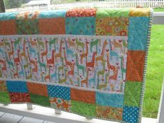 This giraffe crib quilt was sold on Etsy