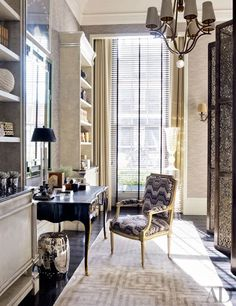 The master suite's study area is outfitted with a Baker mirror and a Jansen armchair covered in a Zoffany flame-stitch pattern; the curtains are of a Sahco satin.