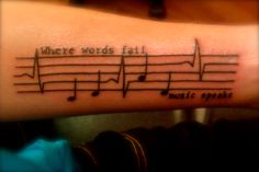 """My first tattoo: """"Where words fail, music speaks""""... the first four notes are from """"Jesus Christ"""" by Brand New, my favorite band."""