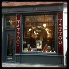Storefront of the Salon Serpent Parlour in Amsterdam. I'm aiming for more script on the outside. Whadda ya think?