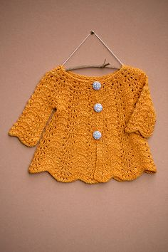 Available to buy on Ravelry: wee Liesl pattern by Ysolda Teague.  4ply.  Starts at 0-6 months