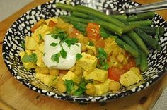 Curried Chickpeas and Tofu - one of my favorite recipes growing up, from the Moosewood cookbook! onion, garlic clove, vegetable oil, ground cumin, ground coriander, turmeric, salt & pepper, cayenne (optional), tofu, chickpeas, tomatoes, optional toppings (fresh cilantro, plain yogurt)