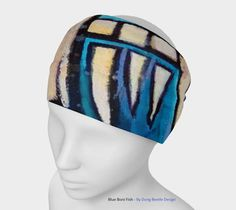 Art meets the most versatile of our accessories. Even though we call it a headband, you can wear it as a scarf or a face warmer too!Perfect for working out, staying warm, or as a pop of colour to add to any look.    Precision cut raw edges  Micro knit fabric made from 85% ecopoly with 15% spandex  Quickdry & Easy care  UV Resistant fabric helps protect your skin from exposure to UV rays  Vibrant fade-proof print  Wear it so many ways!    Care Instructions:  Machine wash and tumble dry. Our…