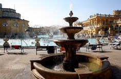 """This winter, plunge into warm turquoise thermal pools with a wintertime trip to Budapest, a historical urban center known as """"The City of Baths."""" There are many indoor and outdoor options for bathers in Budapest. Get your spa on (and try your hand at a game of water chess!) in the spring-fed basins of the Szechenyi Baths, one of the largest public spas in Europe. Budapest, #Hungary #iGottaTravel"""