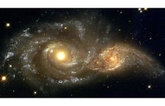 These glowering eyes are the swirling cores of two merging galaxies called NGC 2207 and IC 2163 in Canis Major. Billions of years from now, only one of these two galaxies will remain. Until then, they will slowly pull each other apart  Picture: NASA