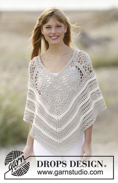 Drops 143-19, Knitted poncho with cables and lace pattern in Nepal