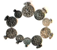 Roskilde Denmark - http://www.thehistoryblog.com/wp-content/uploads/2016/04/Ten-copper-alloy-round-pendants-ornamented-in-late-Viking-Age-style-10th-early-11th-c..jpg