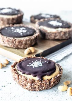 Vegan Peanut Butter tarts. Coconuty crust, creamy cashew and peanut butter filling. Topped with chocolate ganache and sea salt. #peanutbutter #tart #vegan #vegantart #veganganache