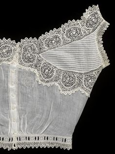 1890. Camisole. V & A Museum. it was worn over a corset and under the clothing.