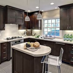 Small L Shaped Kitchen Remodel Ideas small l-shaped kitchen with stainless countertop table traditional