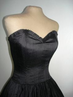 A supremely sexy and simple 50s inspired cocktail dress made from black duchess satin. Have it perfectly made to measure. Any size welcome via Etsy