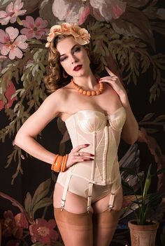 Are you looking for the perfect wedding lingerie? Our Glamour Nouveau Merry Widow is just the thing if you're looking for a strapless alternative to a bra, with a little extra support and shaping. With smoothing powermesh panels, sleek boning and six dainty suspender straps to hang your stockings from, it's ideal for under your dress on the big day! Modeled here by Sam Elson with Shazam and Splendette jewellery