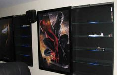 Hidden DVD Storage...behind movie posters hinged to built-in boxes.....theatre room....
