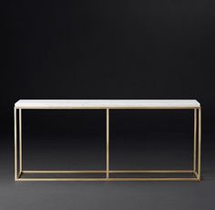 RH Modern's Nicholas Marble Console Table:Pairing marble's luminous warmth with metal's cool luster, this table designed by the Van Thiels is a study in complementary contrasts. Inspired by a 1960s French original, it is a striking surface for display.