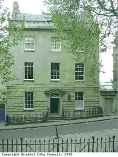 Georgian House, Bristol. There are six floors. Attic rooms where servants slept are hidden by the parapet. Below is the fifth floor, where the family slept. The fourth floor has a drawing room, library and ladies withdrawing room. The third floor is at ground level and there is an entrance hall, a powder room (for powdering wigs), dining and breakfast rooms and a study. Below is a basement kitchen, laundry and housekeeper's room. Sub basement houses a furnace, cistern and rainwater tank.