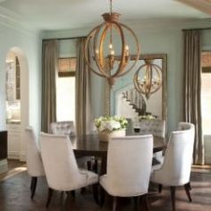 chandelier and round table traditional dining room by Ellen Grasso Inc