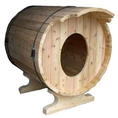 recycled wine barrel doggie house- We used to use these for our show dogs. :) Good times. :)