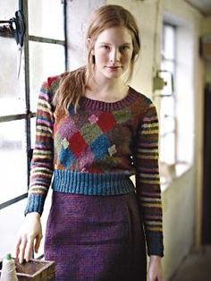 Knit this womens intarsia cropped sweater with striped sleeves from our Tweed Collection. A design by Marie Wallin using Rowan Fine Tweed, a lovely Yorkshire yarn perfect for fairisle and colour work comprising 100% wool. This knitting pattern is suitable for experienced knitters.