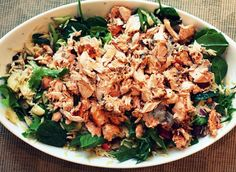 Mediterranean Salmon Salad ~ with orzo, feta, artichoke hearts, red pepper, kalamata olives, arugula topped with a special dressing.