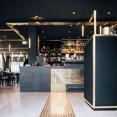 """Build Inc Architects has added a path of narrow brass lines to lead visitors around the different areas of this restaurant in Munich, which is set inside…"""