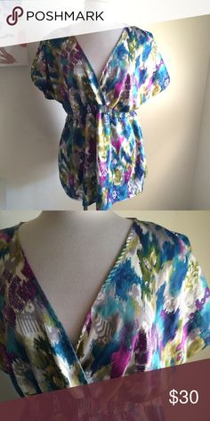 Watercolor blouse Beautiful blouse! It has bright watercolor patterns. Surplice neckline. Short sleeves. Banded at the waist. 100% polyester. Lightweight and flowy. Size 18/20. Lane Bryant Tops Blouses