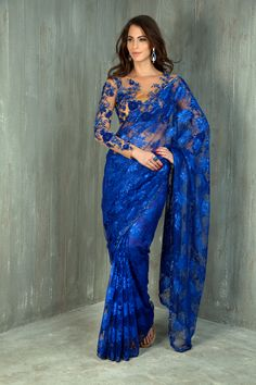 Chantilly lace saree with contrast net blouse embellished with stone, sequins and fancy applique work