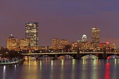 Boston skyline night photography showing landmarks such as John Hancock building, Prudential Center, and Longfellow Bridge captured on an overcast day in December at twilight.  This Boston night photography picture of the famous skyline buildings is available as museum quality photography prints, canvas prints, acrylic prints or metal prints. Prints may be framed and matted to the individual liking and decorating need.  www.RothGalleries.com