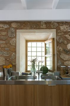... centuries-old stone walls. Lonny I pinned this to show the rustic kitchen stone walls, and all the different natural hues.
