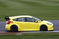 Yellow Ford Focus ST mk3 during race on track