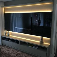 Beautiful TV panel in black lacquer, where the highlight is the illumination . Living Room Modern, Home Living Room, Living Room Decor, Home Room Design, Home Interior Design, Sala Vip, Modern Tv Wall Units, Living Room Tv Unit Designs, Tv Wall Decor