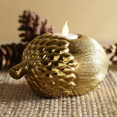 Handcrafted and hand-painted, our ceramic Acorn Tealight Holder is a pretty way to light up your home. Gather several and add to a tablescape.
