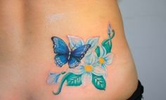 Blue butterfly with flower tattoo