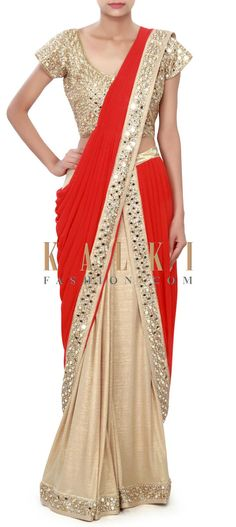 Buy Online from the link below. We ship worldwide (Free Shipping over US$100) Price- $529 Click Anywhere to Tag http://www.kalkifashion.com/red-and-gold-saree-gown-enhanced-in-mirror-and-kundan-embroidery-only-on-kalki.html