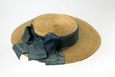 1870 Girl's Hat Culture: English Medium: straw, silk Girl's straw hat trimmed with a band and bow of blue silk ribbon.