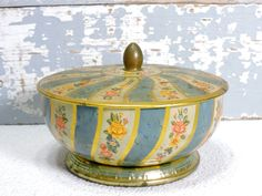 Vintage Tin Tea Powder Container Blue Yellow Gold Pink Floral Art Deco Style  Make Up Jewelry Holder Vintage Storage Decor by SexyTrashVintage on Etsy https://www.etsy.com/listing/253891400/vintage-tin-tea-powder-container-blue