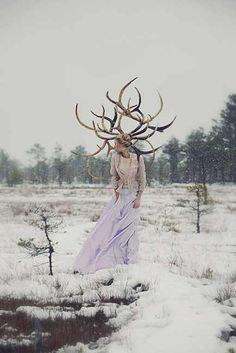 Lovely snow girl with antlers