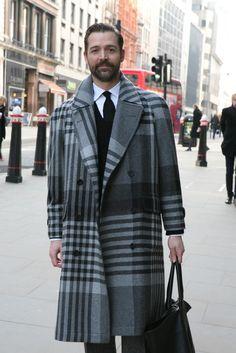 Patrick Grant in plaid overcoat