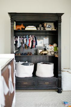 Armoire with hanging rod.  Love everything about it.  Next nursery, or maybe for BC's big boy room with baby keepsakes.