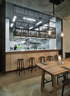Built by Mikhail Kozlov in Moskva, Russian Federation with date Images by Frank Herfort. Holy fox is a bar and restaurant with a perfect location in the very center of Moscow — situated in the downtown neig. Industrial Kitchen Design, Industrial Cafe, Industrial Restaurant, Industrial Apartment, Industrial Shelving, Industrial Lighting, Industrial Closet, Industrial Bookshelf, Industrial Windows