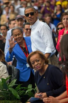 President Barack Obama talks with Rachel Robinson, widow of baseball hall-of-famer Jackie Robinson, before taking his seat with Cuban leader Raul Castro as they attend a exhibition baseball game between the Tampa Bay Rays and the Cuban National team at the Estadio Latinoamericano, Tuesday, March 22, 2016, in Havana. The president's mother-in-law Marian Robinson is in the foreground.