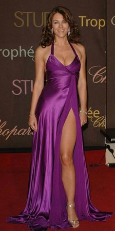 Elizabeth Hurley wearing a lovely purple dress. Elizabeth Hurley, Satin Dresses, Sexy Dresses, Beautiful Dresses, Gorgeous Dress, Formal Dresses, Femmes Les Plus Sexy, Stunning Women, Celebs
