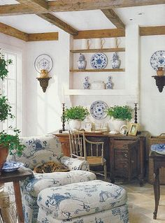 I love this room... The crisp white walls, ceiling detail, sun pouring through the window, blue and white decor and furnishings, green plants... just perfect!