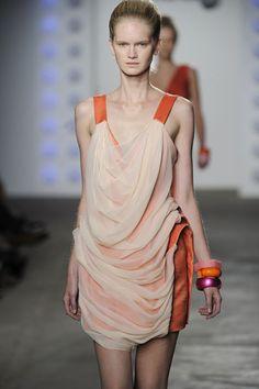 Jade Kang orange background draped dress