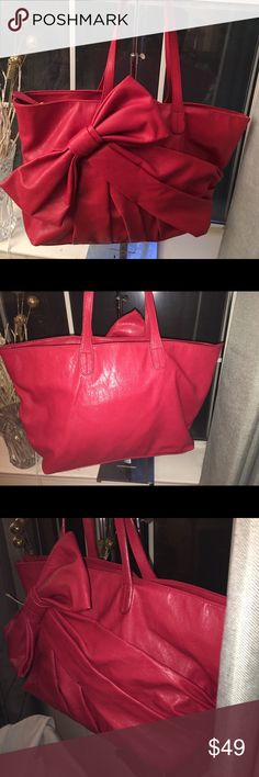 NEW BIG BUDDHa LARGE RED LEATHER TOTE WITH BOW Ladies, you will love this very spacious and chic red TOTE with large bow by BIG BUDDHA. It is perfect for travel or an over night bag. Bring it to school or work to hold everything. Please ask questions Big Buddha Bags Totes