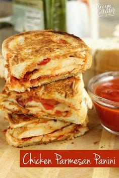 Chicken Parmesan Panini - Grilled sandwiches filled with crispy, breaded chicken breasts topped with marinara sauce, provolone, and roasted red bell peppers.