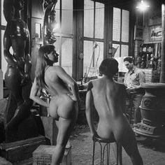 Sculptor Chaim Gross ( 1904 - 1991 ) with his models, in his NYC studio, 1942.   Born in Austria, Gross began sketching at 13. By the time he was 15 he was taking free evening classes at an art academy in Hungary. At 17 he joined the School of Arts & Crafts in Austria and a year later he immigrated to New York where he continued his artistic studies and became an award winning sculptor. Gross also taught sculpture from 1927 to 1987 at the Educational Alliance School, New York, NY...