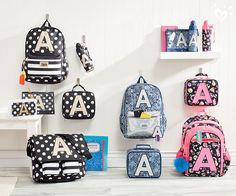 Initial here (and here... and here)! Head back to school in style with initial backpacks and made-tomatch lunch boxes and supplies supplies!