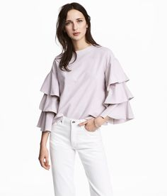 Check this out! Straight-cut top in thick jersey with dropped shoulders and tiered sleeves. - Visit hm.com to see more.
