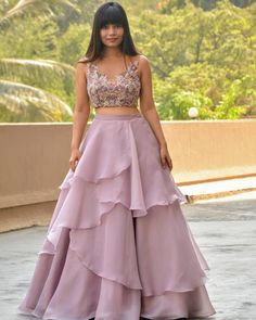 Twenty metres organza, thirty metres cancan with every single layer cut in bias and a delicate multi colored crop top make for a perfect… Party Wear Indian Dresses, Indian Gowns Dresses, Indian Wedding Outfits, Lehenga Gown, Indian Lehenga, Crop Top Outfits, Skirt Outfits, Indian Designer Outfits, Designer Dresses